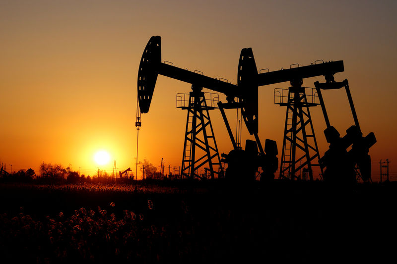Oil prices edge down, pressured by US supply